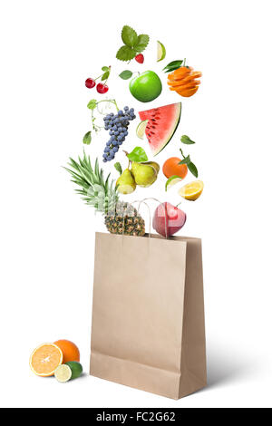 Fruits falling into bag isolated on white - Stock Photo