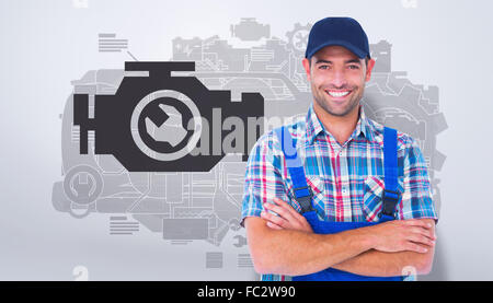 Composite image of happy repairman standing arms crossed on white background - Stock Photo