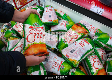 Poultry, deep frozen duck packings in a supermarket - Stock Photo