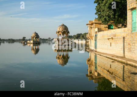 Indian landmarks - Gadi Sagar temple on Gadisar lake with reflection after sunrise. The lake located at Jaisalmer, - Stock Photo