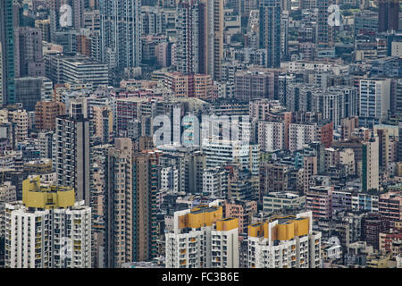 Hong Kong cityscape, crowd buildings in mist - Stock Photo