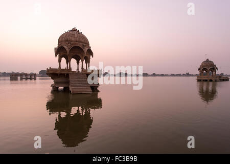 Indian landmarks - Gadi Sagar temple on Gadisar lake during sunrise - Jaisalmer, Rajasthan, North India. - Stock Photo