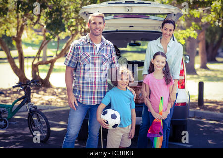 Happy family going for a camping in the park - Stock Photo