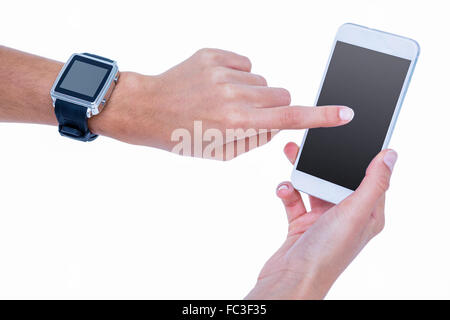 Close up of woman using her smartphone and wearing smartwatch - Stock Photo
