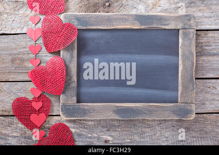 Valentines day decorations around a chalkboard copyspace - Stock Photo