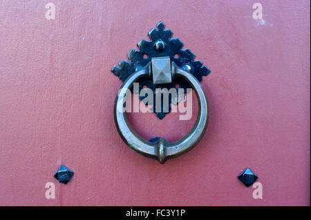 Circular metal door knocker on a wooden church door - Stock Photo