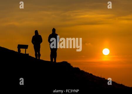 Bratton Camp, Westbury White Horse, Wiltshire, UK. 20th January, 2016. UK weather. A glorious orange sunset casts - Stock Photo