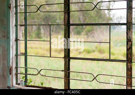 Waste grassland view through a broken windows - Stock Photo