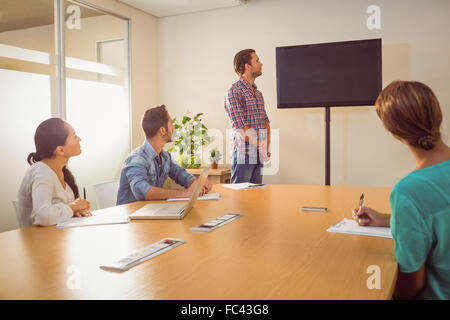 Attentive business team following a presentation - Stock Photo