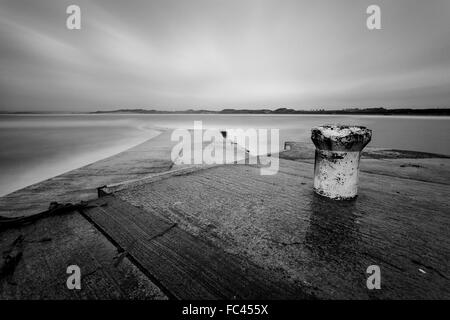 Monochrome long exposure capture of the quayside at Beadnell ,Northumberland - Stock Photo