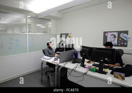 ISRAEL, Beersheba. 20th January. Men working inside EMC Israel Center of Excellence a research company for information - Stock Photo