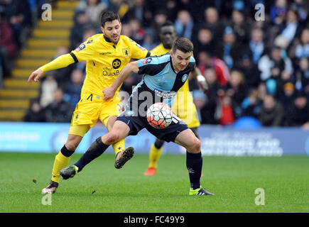 High Wycombe, UK. 9th Jan, 2016. Matthew Bloomfield of Wycombe Wanderers is challenged by Carles Gil of Aston Villa. - Stock Photo