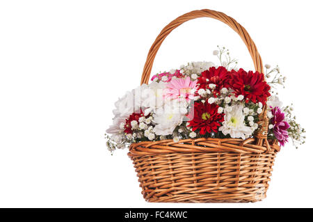 Beautiful bouquet of bright flowers in basket isolated on white - Stock Photo