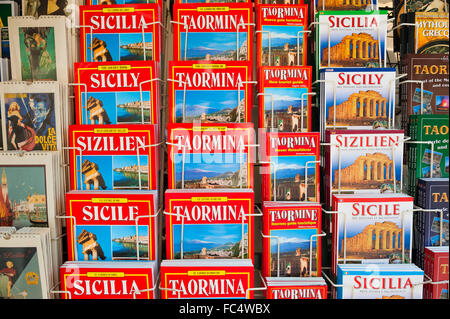 Guide book Sicily, view of a display of guide books in different languages in a street in Taormina, Sicily. - Stock Photo