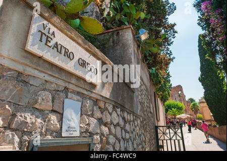 Taormina Greek Theatre, view of the street leading up to the famous ancient hillside Greek theater - the Teatro - Stock Photo