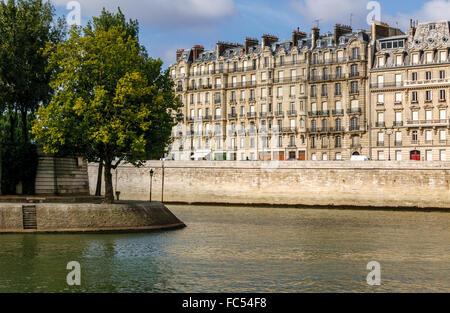 Ile Saint Louis tip and Quai aux Fleurs on Ile de la Cite with Seine river banks and Haussmaniann buildings. Paris, - Stock Photo