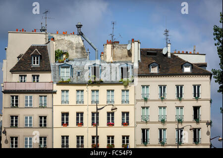 Row of typical Parisian buildings and rooftops along the River Seine in the Sorbonne neighborhood. Rue du Petit - Stock Photo