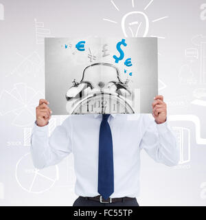 Composite image of tradesman holding blank sign in front of his head - Stock Photo