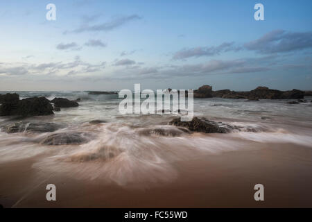 waves on the rocks at Praia do Castelejo - Stock Photo