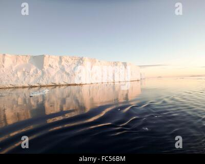 Huge tabular icebergs in Antarctic Sound at twilight in summer. - Stock Photo