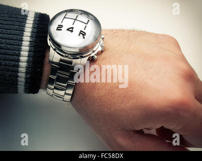 Conceptual image with speed gear stick marks and wirst watch. - Stock Photo