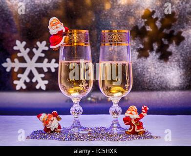 Christmas. champagne, toys gnomes. - Stock Photo