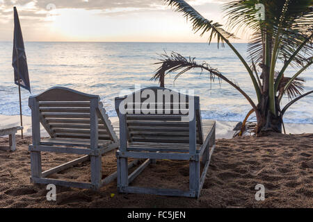 Sri Lanka, Southern Province, Rustic wooden beach loungers on the Tangalle Beach - Stock Photo