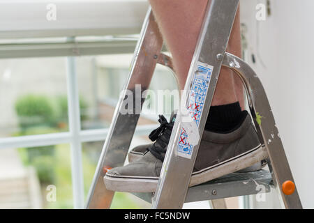 Person on a stepladder Stock Photo