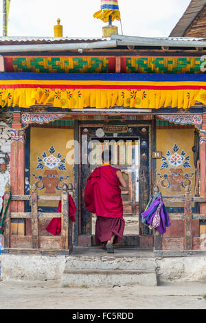 Monk at Tamshing Buddhist Temple, Jakar, Bumthang, Central Bhutan, Asia - Stock Photo