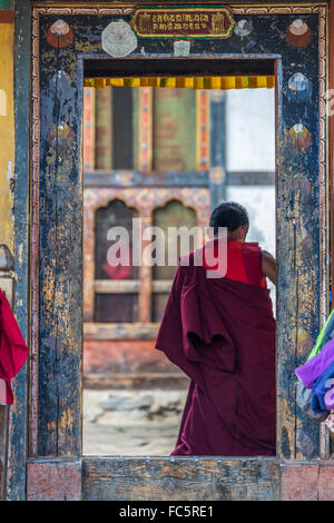Young monk at Tamshing Buddhist Temple, Jakar, Bumthang, Central Bhutan, Asia - Stock Photo