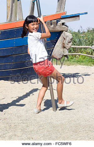 Girl on a climbing pole - Stock Photo