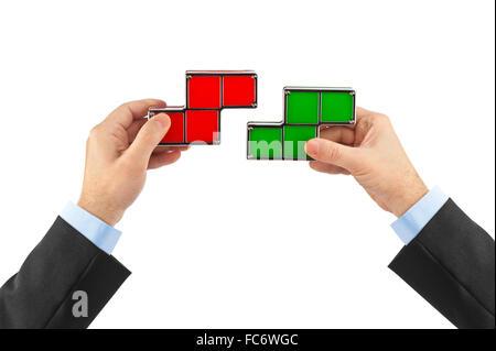 Hands with tetris toy blocks - Stock Photo