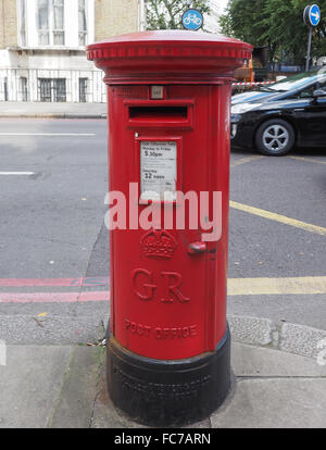 Red mail box in London - Stock Photo