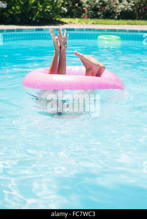 Caucasian woman playing in swimming pool - Stock Photo