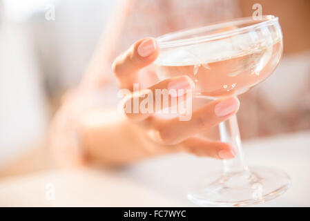 Hispanic woman drinking cocktail - Stock Photo