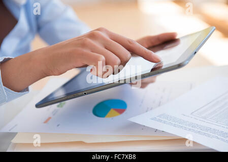 Hispanic businesswoman using digital tablet - Stock Photo