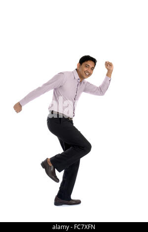 An businessman running away isolated on white background - Stock Photo