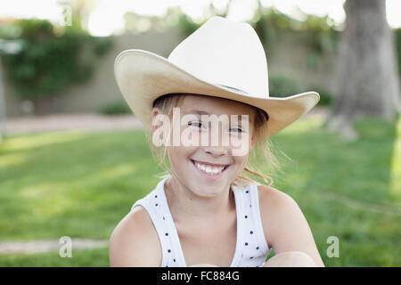 Caucasian girl in cowboy hat - Stock Photo