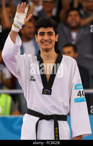 Aykhan Taghizade (AZE) celebrates after being presented with his gold medal. Taekwondo Men's 68kg Final. Crystal - Stock Photo