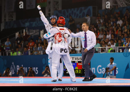 Aykhan Taghizade (AZE, blue) celebrates after winning a point against Karol Robak (POL, red). Taekwondo Men's 68kg - Stock Photo