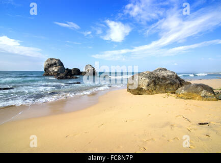 Big stones in the ocean and on a beach of Sri Lanka - Stock Photo
