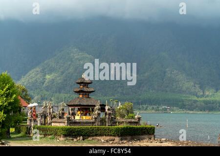 the major Shivaite and water temple Pura Ulun Danu Bratan on the shores of Lake Bratan, Bedugul, Bali, Indonesia - Stock Photo