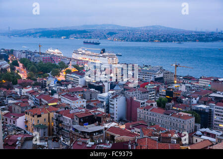 Bosphorus Strait and cruise ship at night seen from Galata Tower, Istanbul, Turkey, Europe - Stock Photo