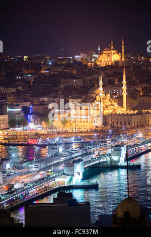 New Mosque (Yeni Cami) and Galata Bridge across Golden Horn at night seen from Galata Tower, Istanbul, Turkey, Europe - Stock Photo