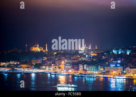 Blue Mosque and Hagia Sophia (Aya Sofya) at night seen from The Galata Tower across the Bosphorus Strait, Istanbul, - Stock Photo