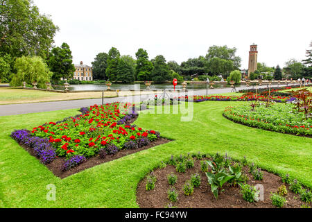 Museum no 1 and the chimney overlooking The Pond at Kew Gardens Royal Botanical Gardens London England UK - Stock Photo