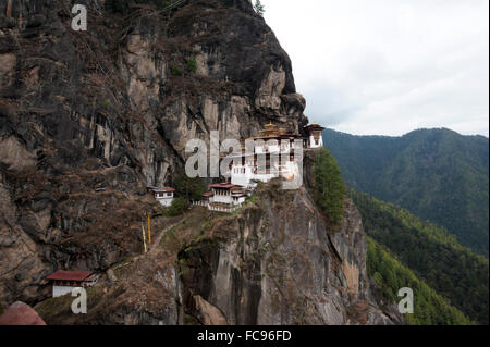 Taktsang Palphug Monastery (Tiger's Nest monastery), a prominent sacred Buddhist site clinging to rock at 3120 metres, - Stock Photo