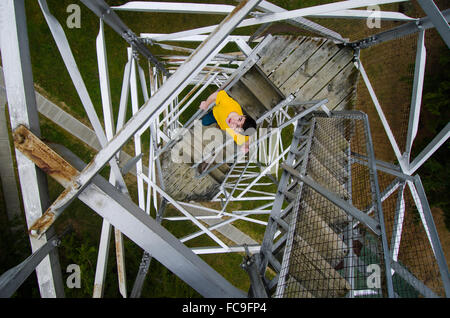 A vertigo-inducing array of criss-crossing metal girders holds together a historic fire lookout tower in the Finger - Stock Photo