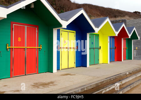 New brightly coloured beach huts, Whitmore Bay, Barry Island, Vale of Glamorgan, South Wales, UK. - Stock Photo