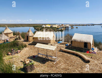 Reed Huts on Uros floating Islands, Lake Titicaca, Peru - Stock Photo